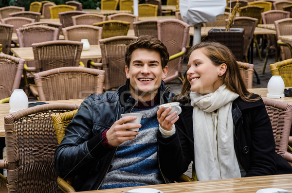 Happy Couple Holding Coffee Cups At Restaurant Stock photo © unkreatives