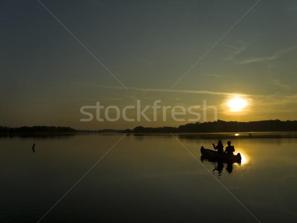 Reise Morgengrauen zwei Personen Sitzung Boot Stock foto © unkreatives