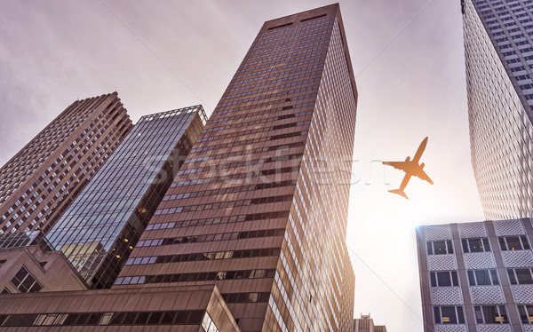 plane over office towers Stock photo © unkreatives