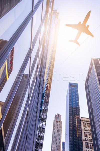 plane over modern buildings Stock photo © unkreatives