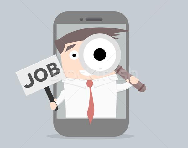 Işadamı iş arama içinde cep telefonu cam Stok fotoğraf © unkreatives