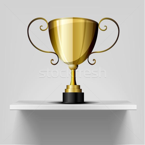 gold trophy on a shelf Stock photo © unkreatives
