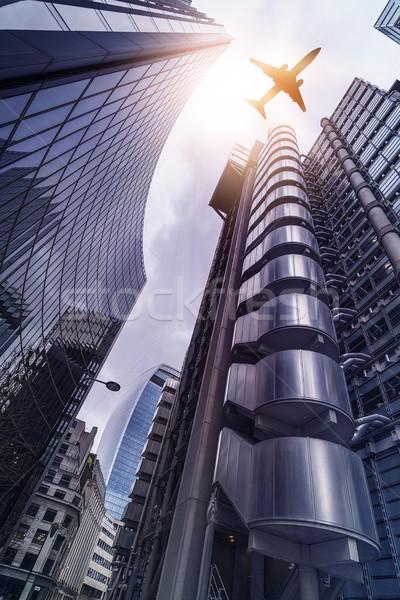 Avião high-rise edifícios voador edifícios de escritórios sol Foto stock © unkreatives
