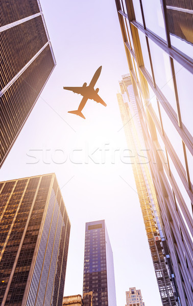 plane over modern office buildings Stock photo © unkreatives