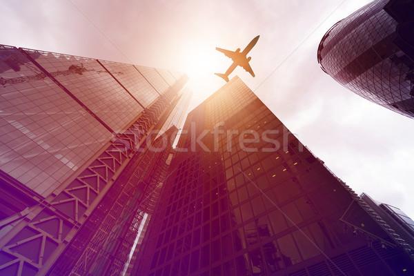 Repülőgép toronyház épületek repülés irodaépületek nap Stock fotó © unkreatives