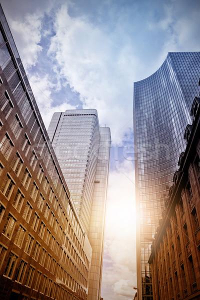 Stockfoto: Kantoor · wolkenkrabbers · zon · moderne · staal · glas
