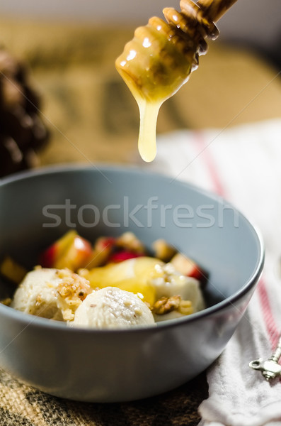 Apple Sauce Dripping From Dipper In Bowl Stock photo © unkreatives