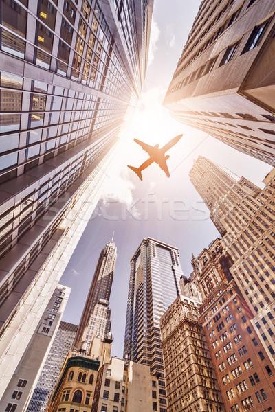 Repülőgép repülés toronyház nap Manhattan pénzügyi negyed Stock fotó © unkreatives