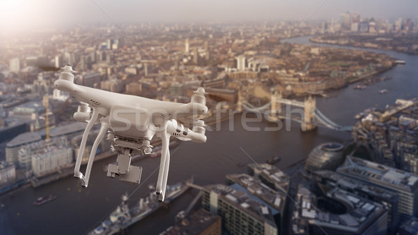 Drone flying over cityscape of London Stock photo © unkreatives