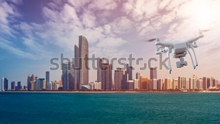 Drone with package flying in front of Abu Dhabi Skyline Stock photo © unkreatives