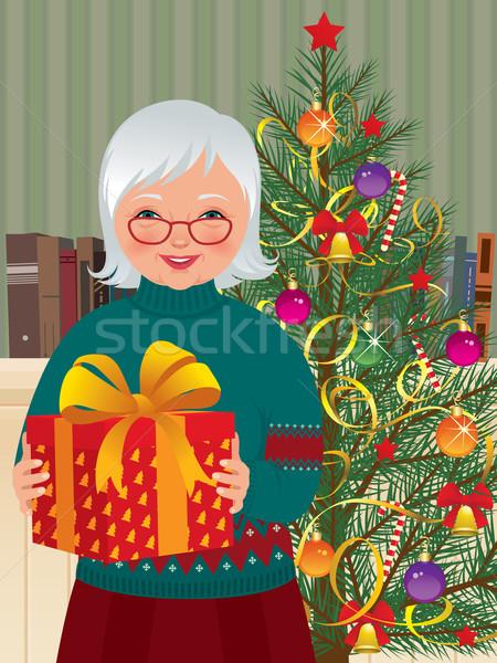 Büyükanne Noel hediye kadın Stok fotoğraf © UrchenkoJulia