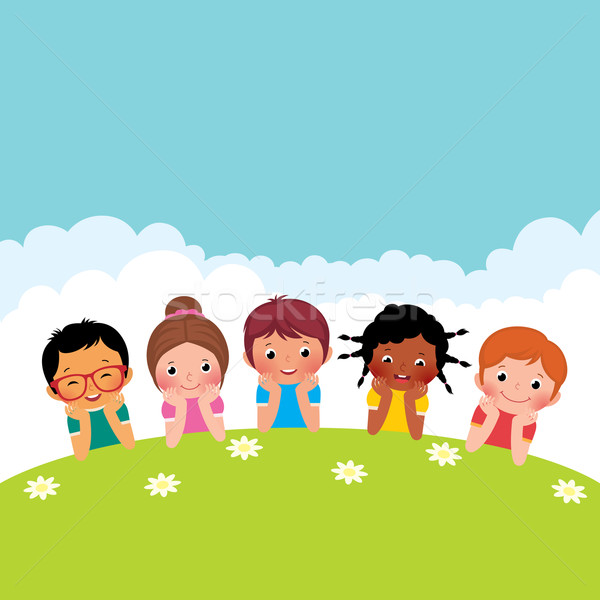Group of happy children boys and girls lying on the grass Stock photo © UrchenkoJulia