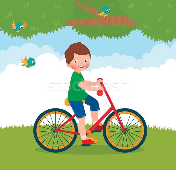 Boy rides a bike Stock photo © UrchenkoJulia