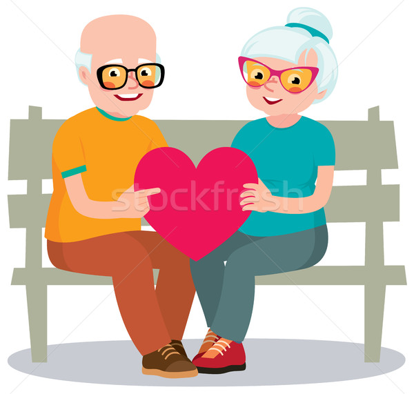 Senior married couple sits on a bench holding a heart symbol Stock photo © UrchenkoJulia