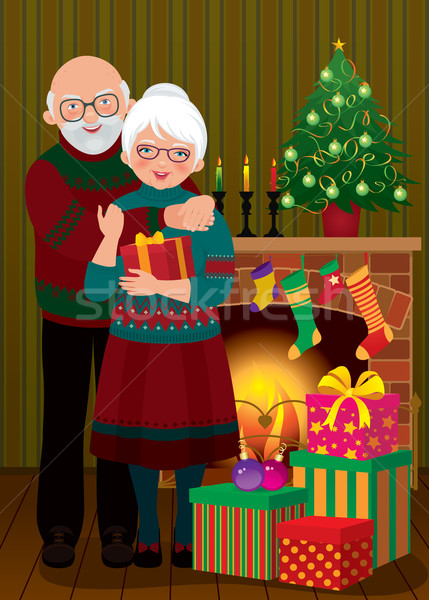 An elderly couple in the fireplace Christmas Stock photo © UrchenkoJulia