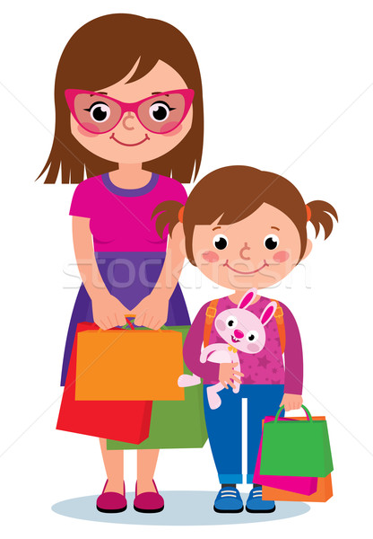 Stock photo: Mother and daughter holding shopping bags isolated on white background