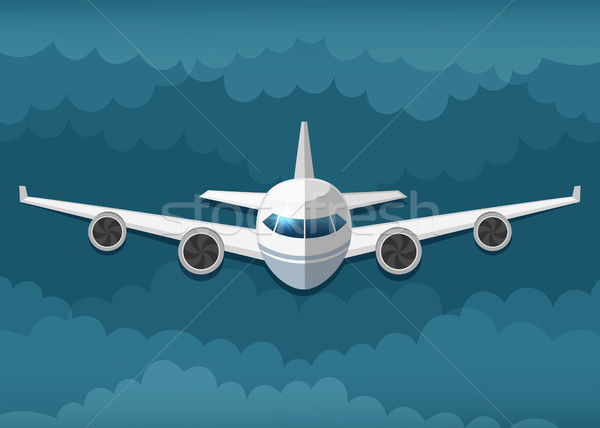 Stock photo: Airplane flies in the clouds