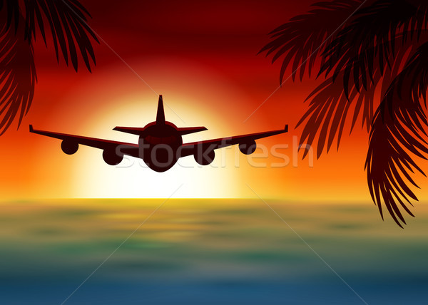 Stock photo: Airplane flies over the sea at sunset