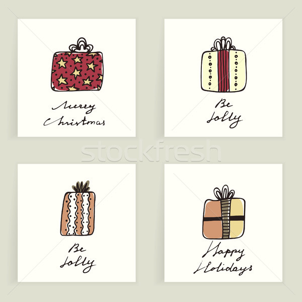 Set of four cards. Hand drawn colorful gifts isolated on white. Winter holidays. Christmas presents. Stock photo © user_10144511