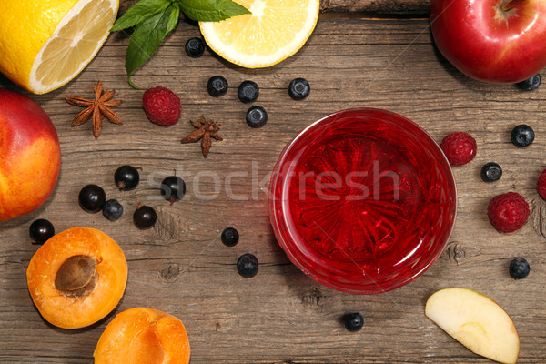 Glass of fruit compot on wooden old table Stock photo © user_11056481