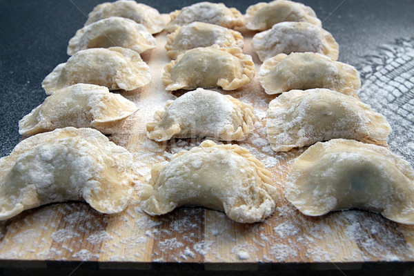 Homemade pierogi dumpling, traditional East European food before Stock photo © user_11056481