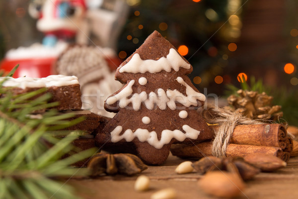 Christmas gingerbread cookies against background branch of fir t Stock photo © user_11056481