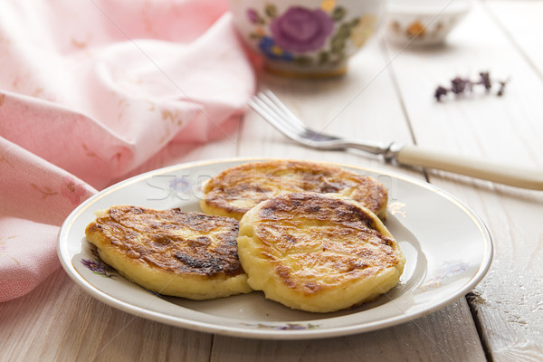 Cottage cheese pancakes on plate with flowers Stock photo © user_11056481