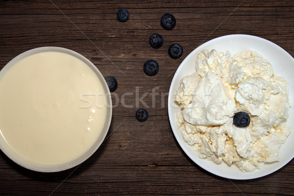 Cottage cheese, sour cream and bilberry on old wooden table. Stock photo © user_11056481