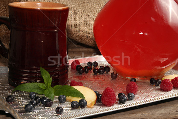 Compot in glass jug and ceramic cup on tray. Stock photo © user_11056481