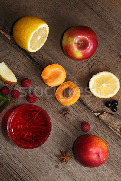 Stock photo: Glass of fruit compot on wooden old table