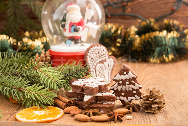 Christmas gingerbread cookies against background sphere with San Stock photo © user_11056481