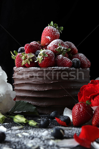 Cake with chocolate decorating with strawberry and raspberry Stock photo © user_11056481