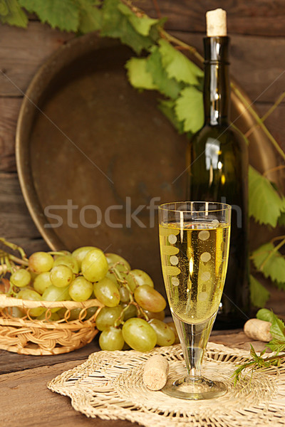 Vintage wine glass against background cluster of grapes and wine Stock photo © user_11056481