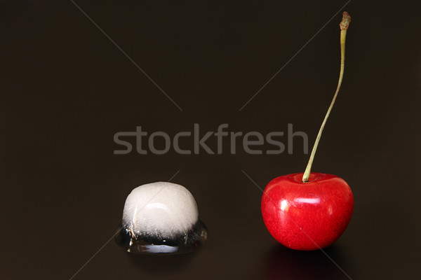 Sweet cherry and  ice cube on black background Stock photo © user_11056481