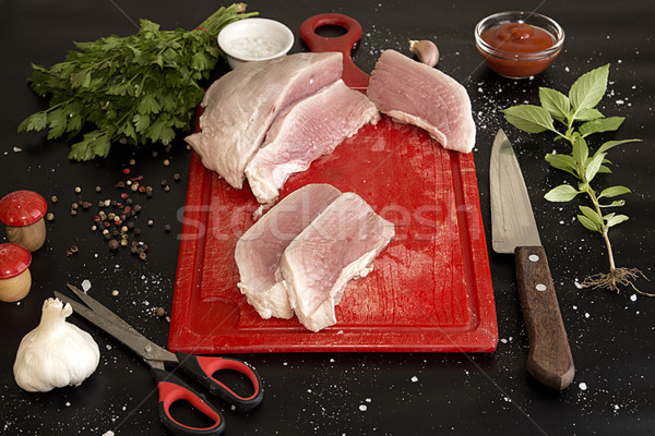 Slices of raw pork on red chopping board. Stock photo © user_11056481