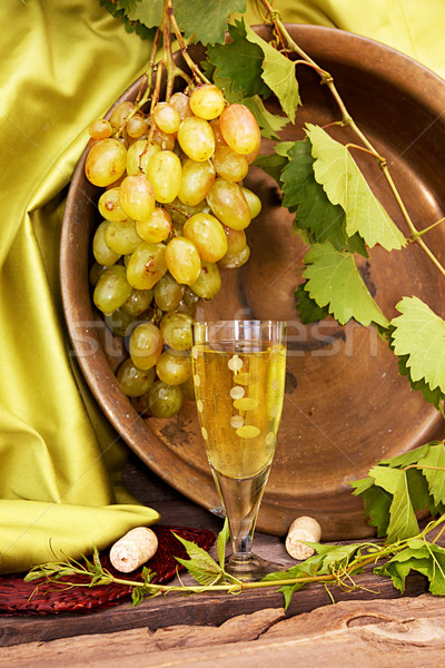 Vintage wine glass against background cluster of grapes and coop Stock photo © user_11056481