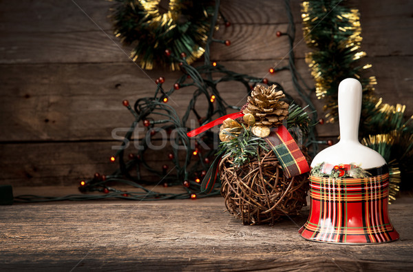 Christmas checkered bell on wooden table against background Chri Stock photo © user_11056481