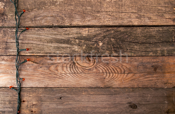 Christmas old wooden background with electrical garland and copy Stock photo © user_11056481