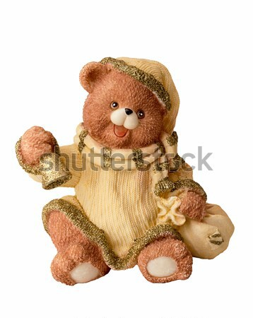 Ceramic bear in hat with Christmas bell isolated on white. Stock photo © user_11056481