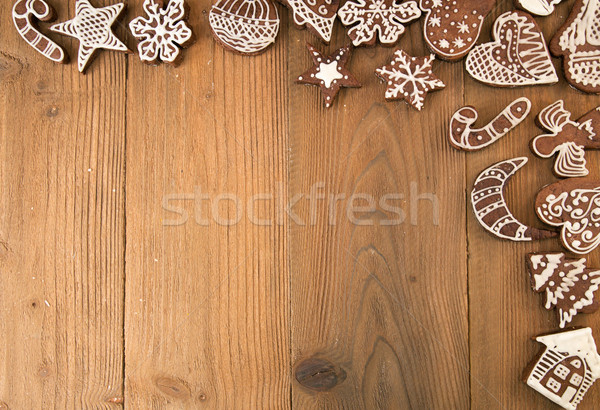 Row of Christmas gingerbread cookies on old wooden table. Stock photo © user_11056481