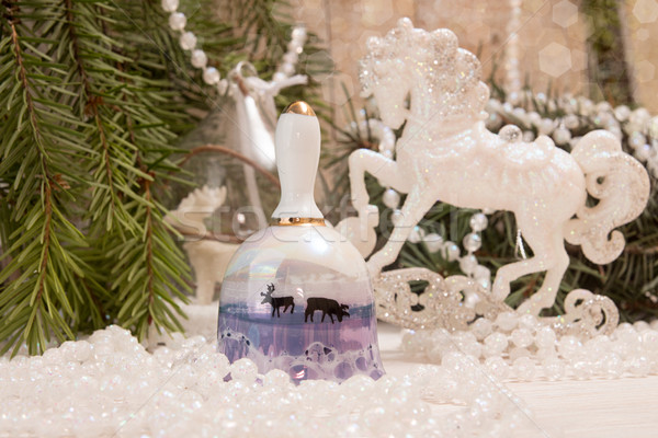 Christmas New Year holiday concept. Bell, white horse, garland Stock photo © user_11056481