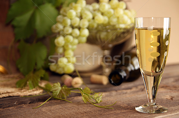 Vintage wine glass against background bunch of grapes and wine b Stock photo © user_11056481