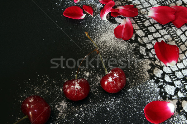 Sweet cherry against black background,  lacy drawing from icing  Stock photo © user_11056481