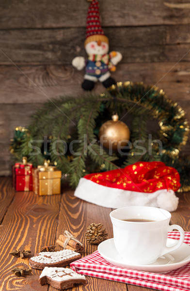 Stock photo: Cup of tea and gingerbread cookies against background branch of