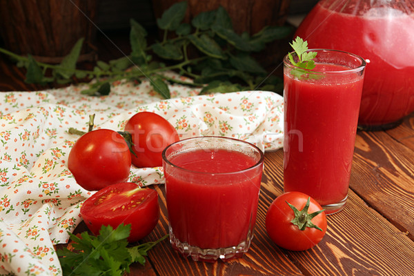 wo glasses,  jug of tomato juice and fresh tomatoes Stock photo © user_11056481