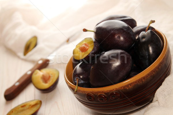 Organic homegrown plums in ceramic bowl Stock photo © user_11056481