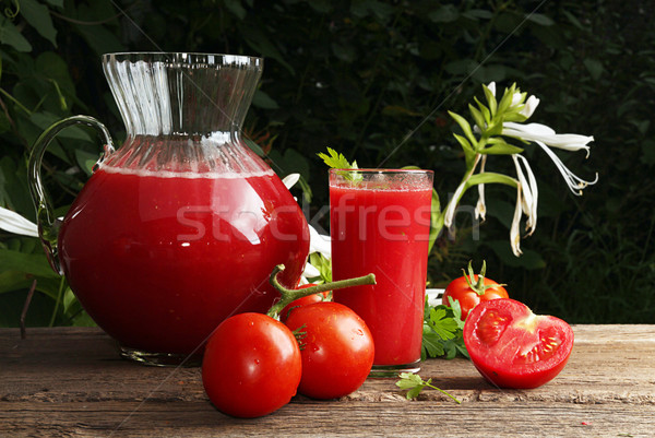 Jug and glass of tomato juice and fresh tomatoes  Stock photo © user_11056481