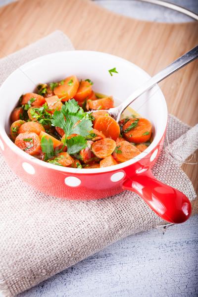 Bebê cenouras cozinhado alho mel salsa Foto stock © user_11224430