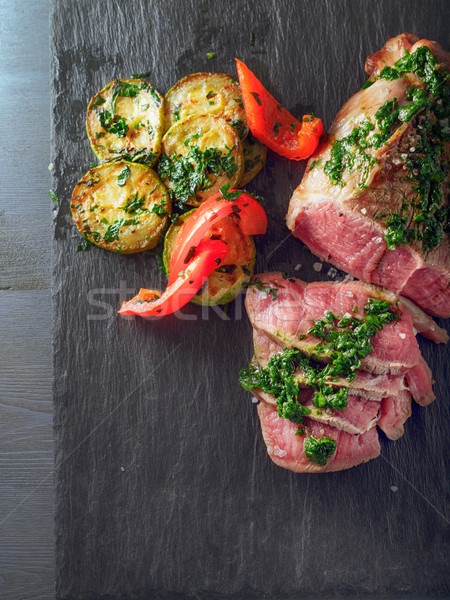 Roast Beef dinner with roasted zucchini, pepper and salsa verde Stock photo © user_11224430