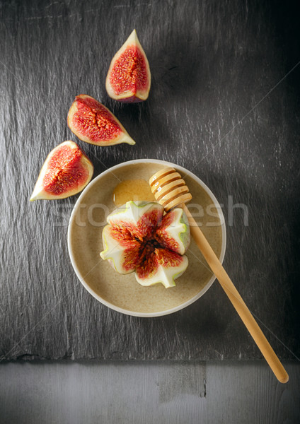 Fresh fig on the plate with honey Stock photo © user_11224430